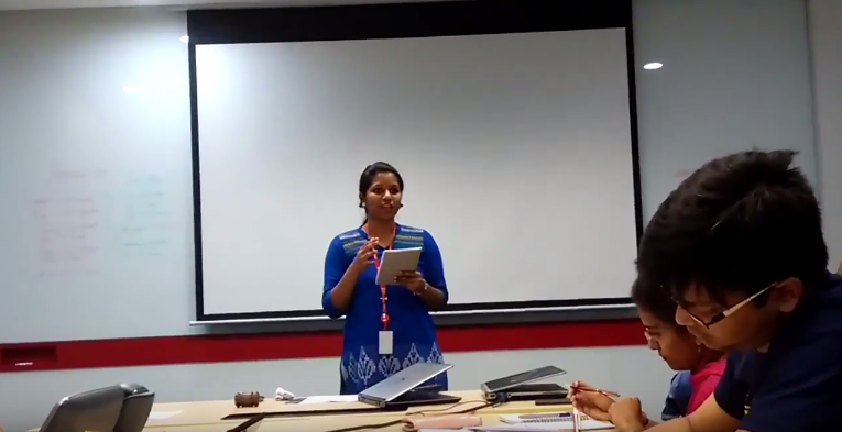 Aarthi evaluating Madhumitha's Project 6 Speech